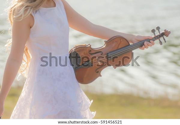 Blonde Girl Music Lover White Dress Stock Photo Edit Now 591456521