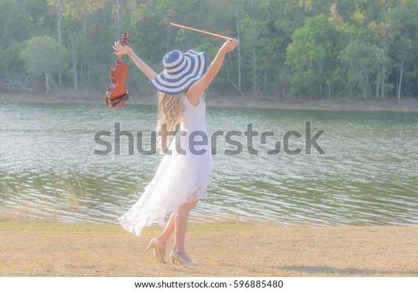 Blonde Girl Music Lover White Dress Stock Photo Edit Now 596885480