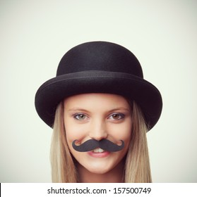 Blonde girl with mustache looking at camera