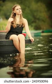 Blonde girl on the lake