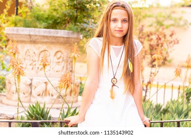 blonde girl with pendant and feathers in nature bucolic style
