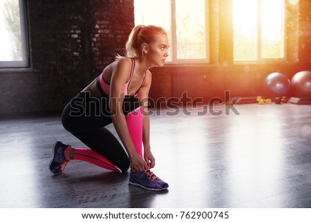Blonde girl ready to start the fitness activity