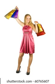 Blonde  girl with shopping bags. Isolated over black background
