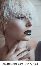 blonde girl with short hair posing fashion