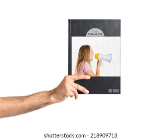 Blonde girl shouting with a megaphone printed on book