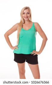 A blonde girl shows different emotions. Isolated photo on a white background. Ideas for photo positioning. Dressed in a green blouse and black shorts