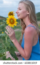 Blonde girl with the sunflower