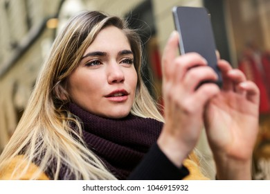 Blonde girl taking a picture