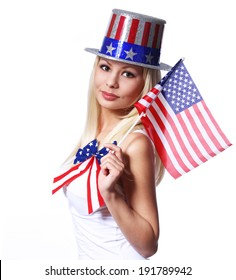 Blonde Girl waving Small American Flag isolated on white. Independence day. Patriotic Young Woman