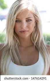 Blonde hair model with green eyes.