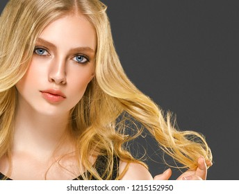 Blonde hair woman with beauty face skin over dark background female portrait