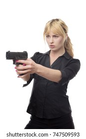 blonde haired business woman pointing a gun at the camera