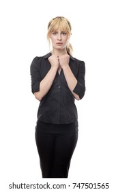 blonde haired business woman standing looking around scared
