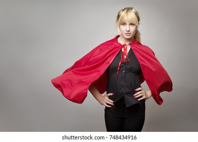 blonde haired business woman wear a superhero cape ready for anything