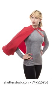 blonde haired fitness woman wearing a grey top and a superhero cape