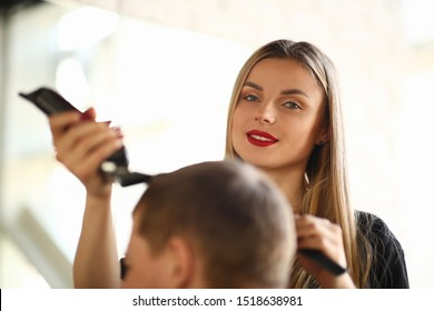 Blonde Hairstylist Cutting Man by Electric Shaver. Beautiful Hairdresser Shave Male Hair by Razor. Female Stylist Making Haircut for Client in Barbershop. Customer Getting Hairdo in Beauty Salon
