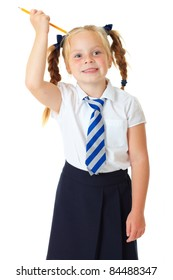 Blonde happy schoolgirl makes funny faces, plays with yellow pencil,  isolated on white