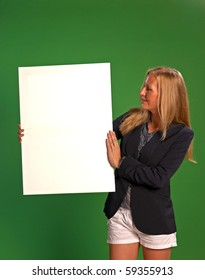 Blonde holding empty board with copy space