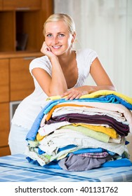 blonde housewife with stack of washed linen