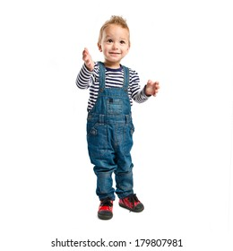 Blonde kid clapping over isolated white background