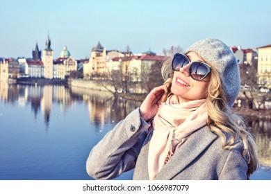 Blonde lady in Prague, Czeh Republic. Charles bridge view on background