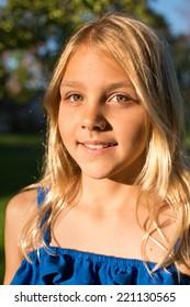 Blonde little girl in blue dress