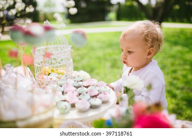 blonde little girl with Easter decorations and Easter eggs