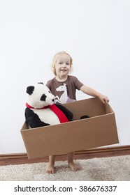 blonde little girl ready to move-with panda bear