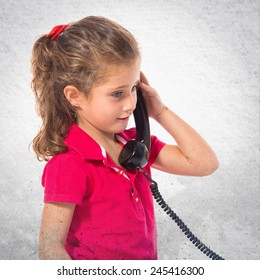 Blonde little girl with vintage phone