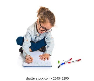 Blonde little girl writing