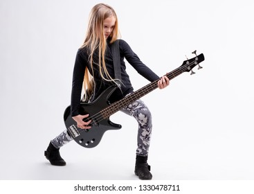 blonde long haired girl is a bass  guitar metal or hard rock player