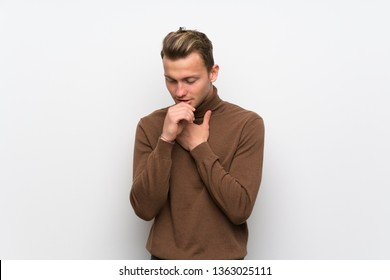 Blonde man over isolated white wall is suffering with cough and feeling bad