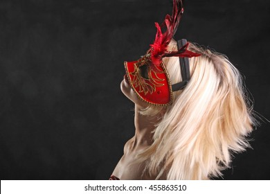 blonde in mask with a beautiful neck on black background