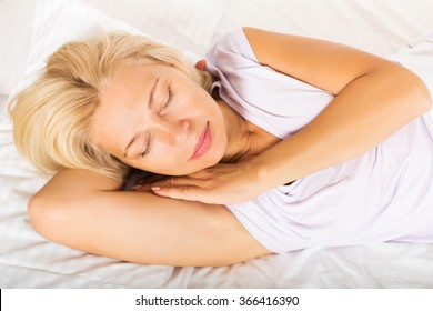 Tanned mature sleeping