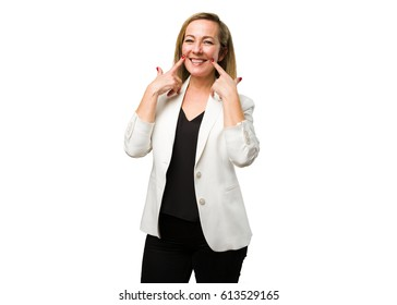 blonde mature woman pointing her mouth
