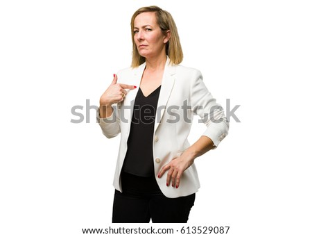blonde mature woman pointing her self stock photo edit now