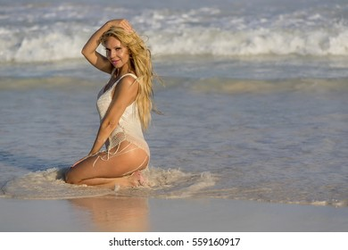 A blonde model enjoying the beach