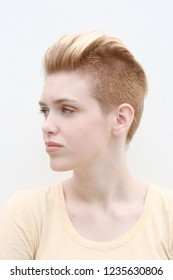Blonde model girl with mohawk hairstyle