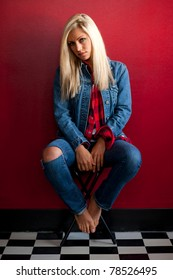 Blonde Model, Jade Bryce, posing in denim and an oversized red flanel shirt.