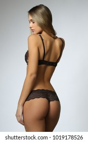 blonde model posing in black lingerie