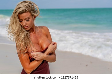 A blonde model posing on a Caribbean island enjoying her vacation