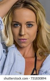 Blonde model posing in a studio environment