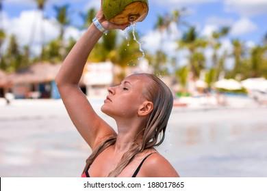 blonde model in water with coconut milk drops