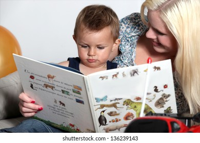Blonde mother with baby