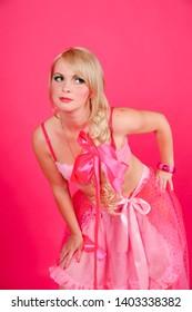 Blonde in pink in studio
