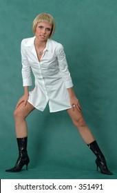 Blonde playful girl in white shirt