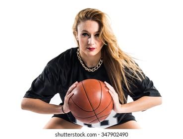 Blonde pretty woman playing basketball