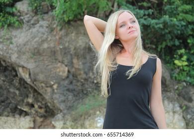 Blonde Russian model in nature.