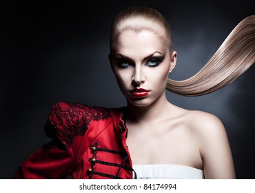 blonde sexy woman in red jacket with red lips and long tail