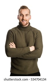 Blonde smiling man wearing a green turtle neck sweater standing against a white background feeling great.